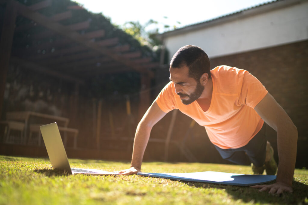 Man having a virtual workout outside of his home.