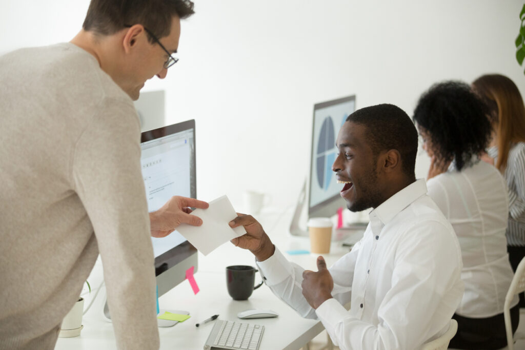 Business owner giving workplace perks to his top-performing employee.